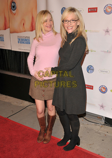 "ANGELA KINSEY & RACHEL HARRIS.attends ""The Business of Being Born"" L.A. Premiere held at The Fine Arts Theatre in Beverly Hills, California, USA, January 14th 2008..full length pink polo neck top jumper pregnant .CAP/DVS.©Debbie VanStory/Capital Pictures"