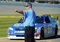 Feb 08, 2009; Daytona Beach, FL, USA; A track worker directs NASCAR Sprint Cup Series driver Terry Labonte to the garage following his run during qualifying for the Daytona 500 at Daytona International Speedway. Mandatory Credit: Mark J. Rebilas-