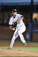 Asheville Tourists pitcher Logan Sawyer (34) delivers a pitch during game two of a double header against the Greenville Drive on April 18, 2015 in Asheville, North Carolina. The Drive defeated the Tourists 10-4. (Tony Farlow/Four Seam Images)
