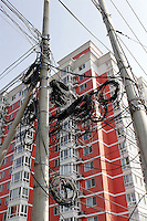 Rolls of redundant power cable are seen hanging on a electric pole in Beijing, China..