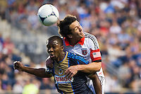 Lewis Neal (24) of DC United heads the ball over Michael LaHoud (13) of the Philadelphia Union. DC United defeated Philadelphia Union 1-0 during a Major League Soccer (MLS) match at PPL Park in Chester, PA, on June 16, 2012.