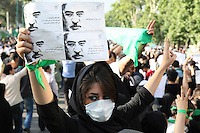 A young woman wearing a mask as a symbol of her silent protest. An estimated one million people formed a human chain along Vali asr Avenue, the longest street in Tehran. Following a disputed election result, thousands of supporters of opposition candidate Mir-Hossein Mousavi took to the streets in protest.