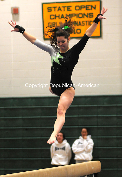 NEW MILFORD, CT, 10 FEBRUARY 2011-021011JS06--New Milford's Colleen Menard competes on the beam during the S.W.C. gymnastics championships Thursday at New Milford High School in New Milford. <br /> Jim Shannon Republican-American