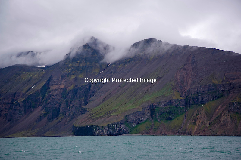Clouds Hanging over Husavik Mountains in Skjalfandi Bay in North Iceland