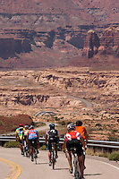Cyclists descend to the Colorado River and HIte Crossing on Lake Powell and the end of the more-than-400-mile ride. The Red Rock Canyons Tour, organized by Lizard Head Cycling Tours, wound through 400 miles of the desert southwest. The route traveled through canyons and national monuments in Colorado, Utah and Arizona, ending at Lake Powell. (Kevin Moloney for the New York Times)