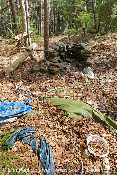 Abandoned campsite along a tributary of the Wild Ammonoosuc River, on the side of Mt. Blue, in Kinsman Notch of the White Mountains, New Hampshire. Camping gear was left behind and is now scattered throughout the site.