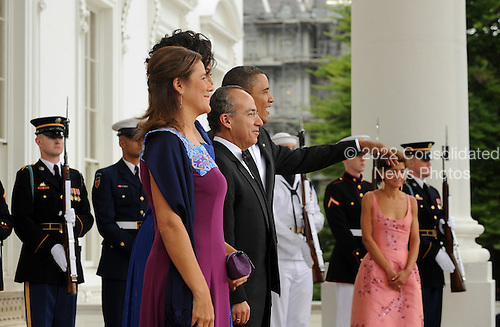 United States President Barack Obama and First Lady Michelle Obama welcome President Felipe Calderon of Mexico and Mexican First Lady Margarita Zavala on the North Portico of the White House for a State Dinner in Washington on Wednesday, May 19, 2010.   .Credit: Roger L. Wollenberg - Pool via CNP