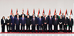 Palestinian President Mahmoud Abbas (C) and the new government pose for a family picture during the swearing in ceremony of the new government at the Palestinian Authority's headquarters in the West Bank town of Ramallah, 13 April 2019. Photo by Thaer Ganaim