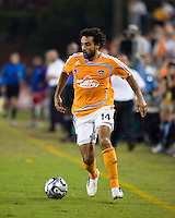 Houston Dynamo midfielder Dwayne De Rosario (14) dribbles the ball.  Houston Dynamo defeated FC Dallas 4-1 at Robertson Stadium in Houston, TX on November 2, 2007.  Houston Dynamo won the Western Conference semifinal series with an aggregate score of 4-2.