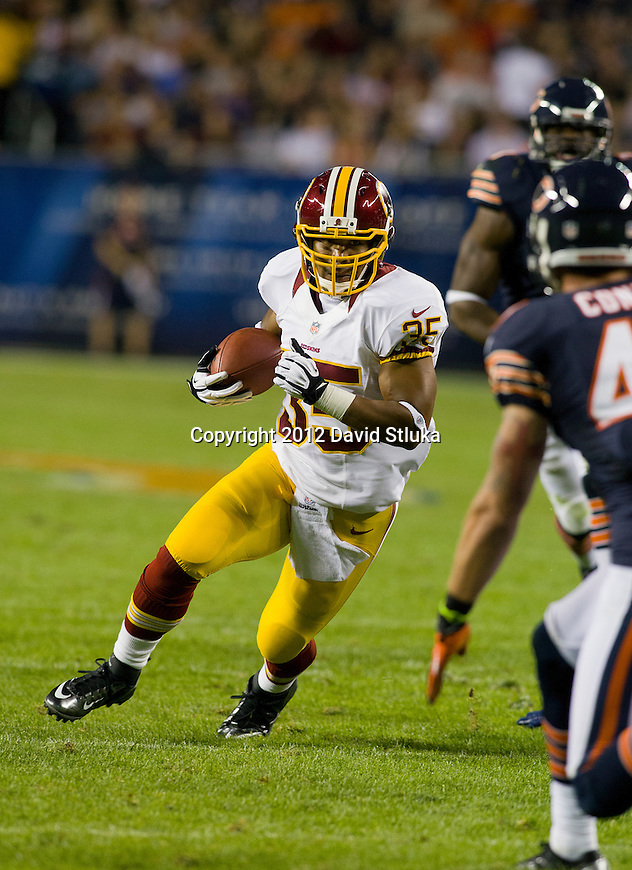 Washington Redskins running back Evan Royster (35) carries the ball during an NFL preseason week 2 football game against the Chicago Bears on August 18, 2012 in Chicago. The Bears won 33-31. (AP Photo/David Stluka)