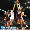 Lorrie Dellacroce #10 of Mepham, right, goes up for a rebound during a Nassau varsity girls basketball game against MacArthur at NYCB Live's Nassau Coliseum in Uniondale on Saturday, Dec. 23, 2017. Mepham won by a score of 45-40.