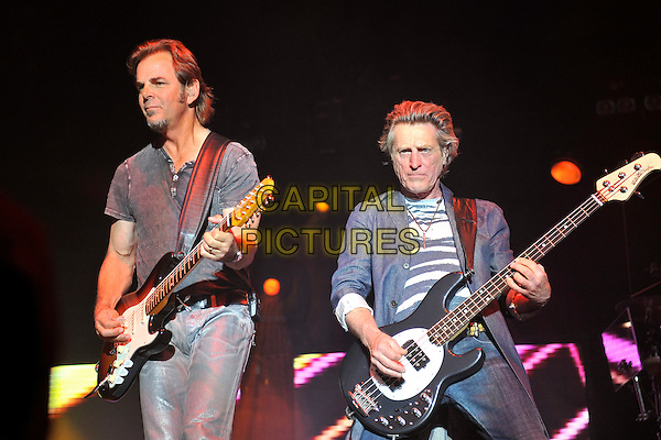 Journey - Jonathan Cain & Ross Valory.Journey performing live at Wembley Arena, London, England..June 4th, 2011.bang group stage concert live gig performance music half length black guitar grey gray top t-shirt bass jacket blue.CAP/MAR.© Martin Harris/Capital Pictures.