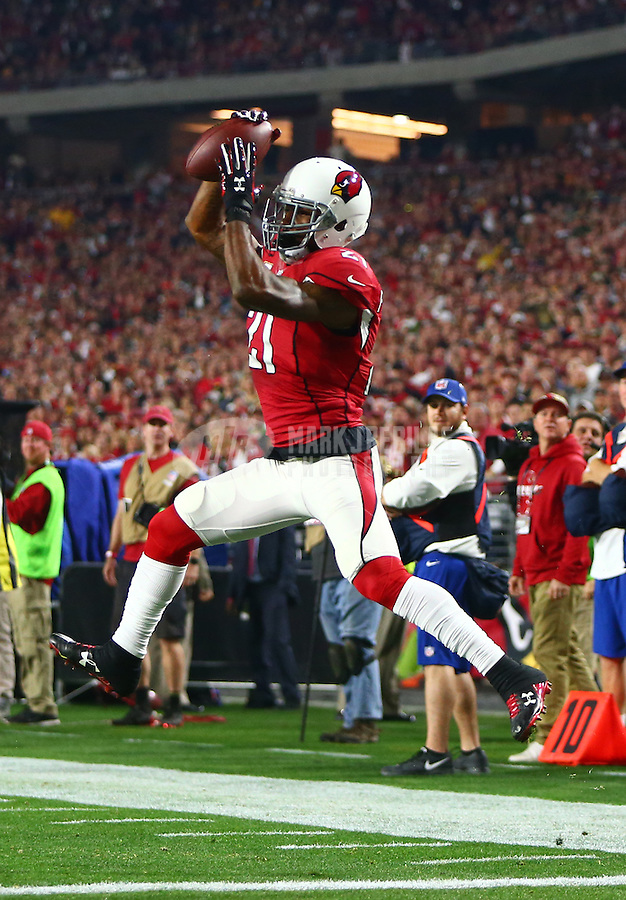 Jan 16, 2016; Glendale, AZ, USA; Arizona Cardinals cornerback Patrick Peterson (21) intercepts a pass against the Green Bay Packers during an NFC Divisional round playoff game at University of Phoenix Stadium. The play was negated on a penalty. Mandatory Credit: Mark J. Rebilas-USA TODAY Sports