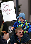 Richard Medley and his son Aden, 7, participate in a rally for state workers at the Legislature in Carson City, Nev., on Monday, Feb. 21, 2011. .Photo by Cathleen Allison