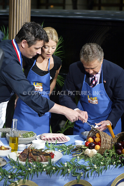 Regis Philbin and Kelly Ripa doing a cooking segment for  'Regis and Kelly Show' New York, June 19, 2004. Please byline: PHILIP VAUGHAN/ACE Pictures.   .. *** ***  ..All Celebrity Entertainment, Inc:  ..contact: Alecsey Boldeskul (646) 267-6913 ..Philip Vaughan (646) 769-0430..e-mail: info@nyphotopress.com
