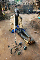 Ongara Dennis, 12, has adjusted to life in the camp under the worst of circumstances creating a toy truck/lorry out of wire and other discarded materials. He lost is parents in an attack on the camp and now lives with is uncle in Abaku IPD camp 42 Kilometers east of Lira. (Rick D'Elia)