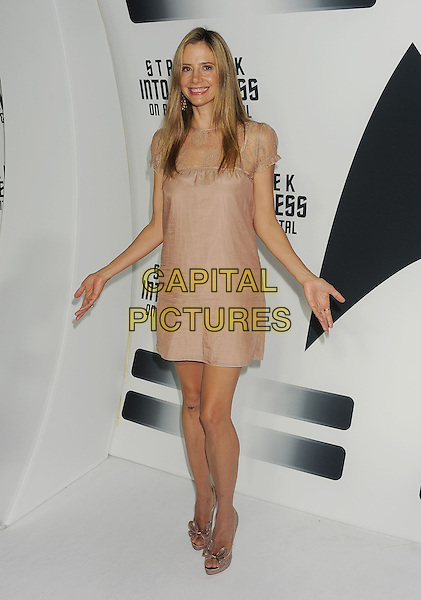 Mira Sorvino<br /> &quot;Star Trek Into Darkness&quot; DVD/Blu-Ray Release held at the California Science Center, Los Angeles, California, USA.<br /> September 10th, 2013<br /> full length dress beige lace hands arms<br /> CAP/ROT/TM<br /> &copy;Tony Michaels/Roth Stock/Capital Pictures