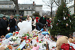 NEWTOWN, CT-17 December 2012-121712LW04 - Mourners pay tribute to the victims of the Sandy Hook Elementary School shooting at the site of a makeshift memorial in Newtown at the corner of Washington Avenue and Church Hill Road Monday. Laraine Weschler