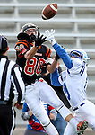 SIOUX FALLS, SD - OCTOBER 16:  Logan Uttecht #80 from Washington tries to haul in the pass while being defended by Nathan Trotter #9 from Rapid City Stevens in the first half of their game Friday night at Howard Wood Field. (Photo by Dave Eggen/Inertia)