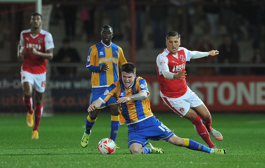 Fleetwood Town's Antoni Sarcevic fouls Shrewsbury Town's Liam McAlinden<br /> <br /> Photographer Dave Howarth/CameraSport<br /> <br /> Football - Johnstone's Paint Trophy Northern Section Second Round - Fleetwood Town v Shrewsbury Town - Tuesday 6th October 2015 - Highbury Stadium - Fleetwood<br />  <br /> &copy; CameraSport - 43 Linden Ave. Countesthorpe. Leicester. England. LE8 5PG - Tel: +44 (0) 116 277 4147 - admin@camerasport.com - www.camerasport.com