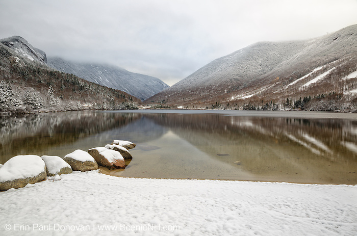 Franconia Notch State Park in Franconia, New Hampshire USA from Echo Lake during the autumn months after a dusting of snow.
