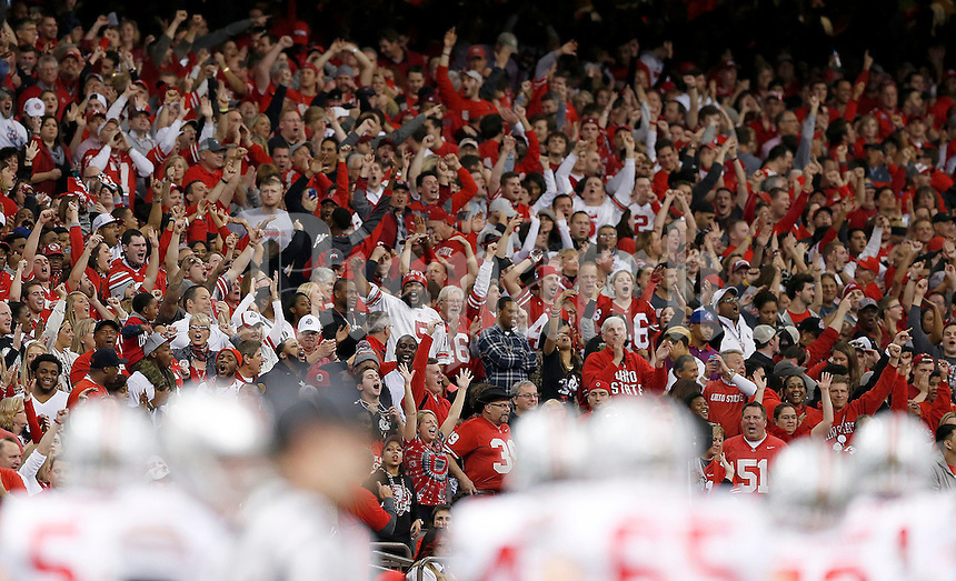 Fans cheer during the fourth quarter in the Allstate Sugar Bowl college football playoff semifinal at Mercedes-Benz Superdome in New Orleans on Thursday, January 1, 2015. (Columbus Dispatch photo by Jonathan Quilter)