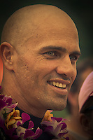 HALEIWA, HI (Thursday Dec. 3, 2009)  kelly Slater (USA) The opening ceremony of the Quiksilver in Memory of Eddie Aikau was held today at Waimea Bay. This year's event is the 25th Anniversary  and will be held on one day , between December 1, 2009 and February 28, 2010, when the waves eceed the  20 foot  minimum threshold and the 28 invitees will compete for the $98.000 prize purse...The northern hemisphere winter months on the North Shore signal a concentration of surfing activity with some of the best surfers in the world taking advantage of swells originating in the stormy Northern Pacific. Notable North Shore spots include Waimea Bay, Off The Wall, Backdoor, Log Cabins, Rockpiles and Sunset Beach... Ehukai Beach is more  commonly known as Pipeline and is the most notable surfing spot on the North Shore. It is considered a prime spot for competitions due to its close proximity to the beach, giving spectators, judges, and photographers a great view...The North Shore is considered to be one the surfing world's must see locations and every December hosts three competitions, which make up the Triple Crown of Surfing. The three men's competitions are the Reef Hawaiian Pro at Haleiwa, the O'Neill World Cup of Surfing at Sunset Beach, and the Billabong Pipeline Masters. The three women's competitions are the Reef Hawaiian Pro at Haleiwa, the Gidget Pro at Sunset Beach, and the Billabong Pro on the neighboring island of Maui...Photo: Joliphotos.com