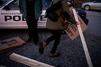 Occupy New Hampshire protestors prepare demonstration signs as former senator Rick Santorum speaks to a crowd made primarily of media and protestors outside Belmont Hall and Restaurant in Manchest, New Hampshire, on Jan. 6, 2012.  Santorum is seeking the 2012 GOP Republican presidential nomination.  Protestors were primarily from the Occupy New Hampshire group..