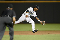 Second baseman Giovanny Alfonzo (6) of the Columbia Fireflies fields a ground ball during a game against the Charleston RiverDogs on Wednesday, August 29, 2018, at Spirit Communications Park in Columbia, South Carolina. Charleston won, 6-1. (Tom Priddy/Four Seam Images)