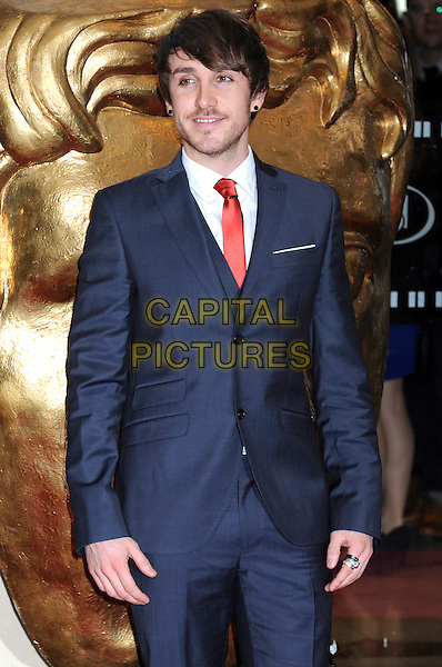 Kye Sones.Arrivals at the British Academy Children's Awards at The Hilton, Park Lane, London, England..November 25th, 2012.BAFTA half length blue suit white shirt red tie stubble facial hair .CAP/PP/BK.©Bob Kent/PP/Capital Pictures