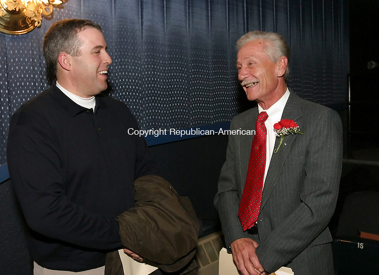 SEYMOUR, CT 12/03/07- 120307BZ02- Scott Barton, former Seymour First Selectman, left, shares a laugh with Seymour First Selectman Robert J. Koskelowski after the Town of Seymour 2007 municipal inauguration ceremony at the Strand Theater in Seymour Monday night.<br /> Jamison C. Bazinet Republican-American