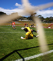 Waikato's Daniel Peat beats Jim Bannatyne to score from the penalty spot..NZFC soccer  - Team Wellington v Waikato FC at Newtown Park, Wellington. Sunday, 20 December 2009. Photo: Dave Lintott/lintottphoto.co.nz
