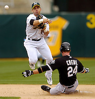 Joe Crede of the Chicago White Sox is out at second base as Marco Scutaro throws to first for the double play in the third inning against the Oakland Athletics at the McAfee Coliseum Wednesday April 27, 2005, in  Oakland, Calif. (Alan Greth/Contra Costa Times)