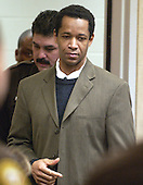 Convicted sniper John Allen Muhammad is escorted into Courtroom 10 at the Virginia Beach Circuit Court in Virginia Beach, Virginia on Monday November 24, 2003. The jury is beginning its second day of deliberation in the sentencing phase of the trial. <br /> Credit: Davis Turner - Pool via CNP