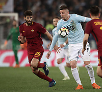 Calcio, Serie A: S.S. Lazio - A.S. Roma, stadio Olimpico, Roma, 15 aprile 2018. <br /> Lazio's Sergej Milinkovic (r) in action with Roma's Federico Fazio (l) during the Italian Serie A football match between S.S. Lazio and A.S. Roma at Rome's Olympic stadium, Rome on April 15, 2018.<br /> UPDATE IMAGES PRESS/Isabella Bonotto