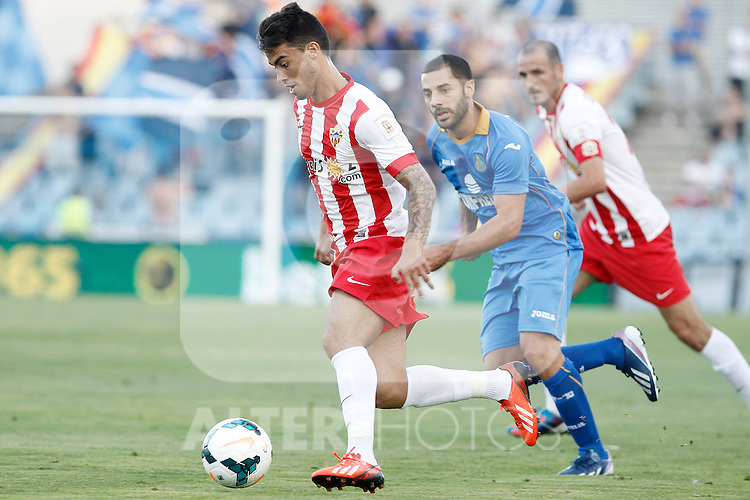 Getafe's Mehdi Lacen (r) and Almeria's Suso Fernandez during La Liga match.August 23,2013. (ALTERPHOTOS/Acero)