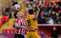 Lincoln City's Shay McCartan vies for possession with Northampton Town's Jordan Turnbull<br /> <br /> Photographer Chris Vaughan/CameraSport<br /> <br /> Emirates FA Cup First Round - Lincoln City v Northampton Town - Saturday 10th November 2018 - Sincil Bank - Lincoln<br />  <br /> World Copyright &copy; 2018 CameraSport. All rights reserved. 43 Linden Ave. Countesthorpe. Leicester. England. LE8 5PG - Tel: +44 (0) 116 277 4147 - admin@camerasport.com - www.camerasport.com