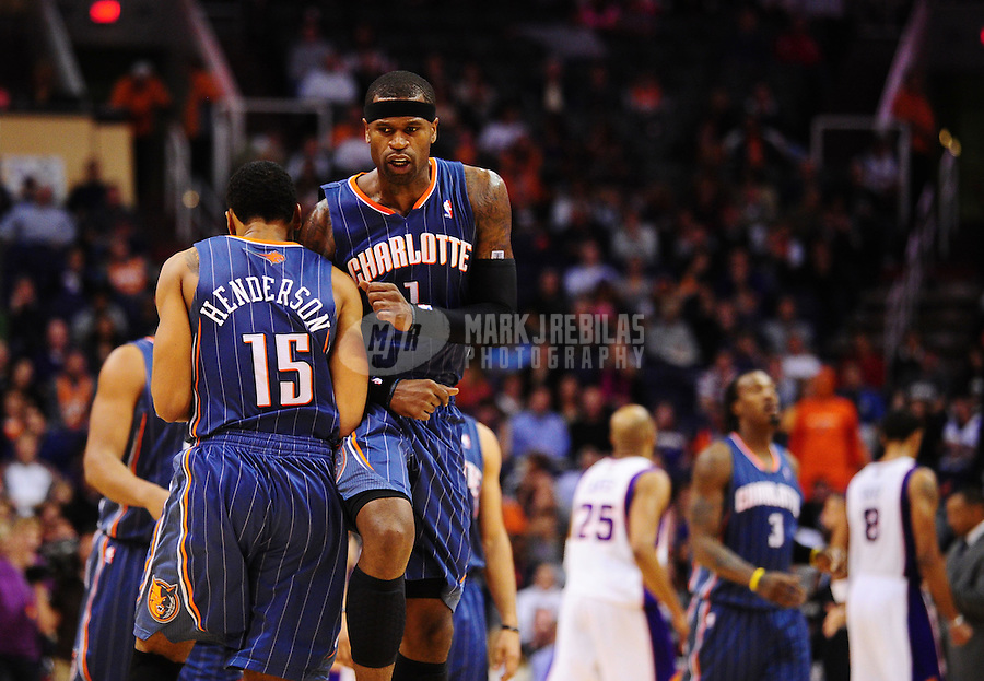 Jan. 26, 2011; Phoenix, AZ, USA; Charlotte Bobcats guard (1) Stephen Jackson celebrates with guard (15) Gerald Henderson in the fourth quarter against the Phoenix Suns at the US Airways Center. The Bobcats defeated the Suns 114-107. Mandatory Credit: Mark J. Rebilas-