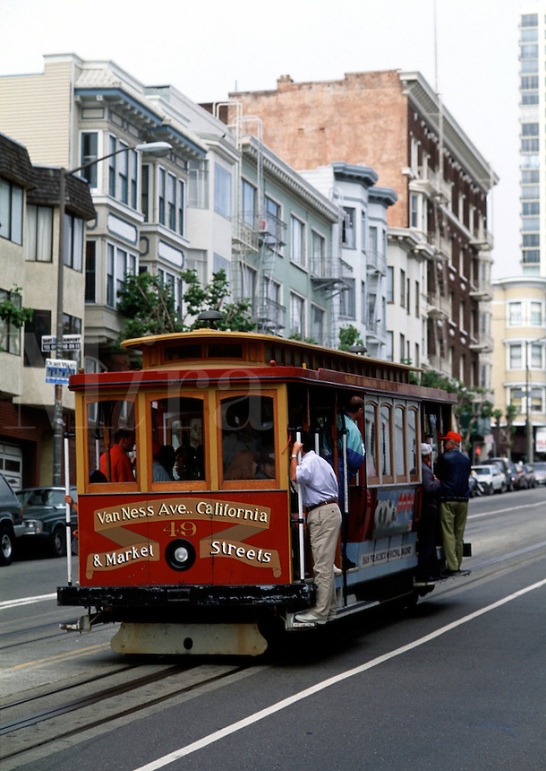 A cable car travels on Market Street. San Francisco, California.