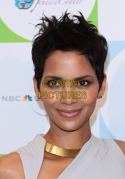 HALLE BERRY.2010 Jenesse Silver Rose  Gala & Auction held at The Beverly Hills Hotel, Beverly Hills, California, USA..April 18th, 2010.headshot portrait gold necklace beige grey gray.CAP/ADM/TC.©T. Conrad/AdMedia/Capital Pictures.