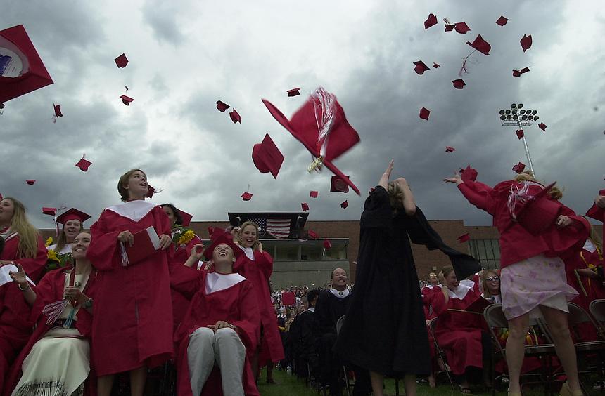 May 2002: Caps fly after the 2002 Durango High School graduation ceremony in Durango, Colorado.