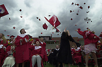 May 2002: Caps fly after the 2002 Durango High School graduation ceremony in Durango, Colorado.