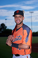 AZL Giants Orange infielder Enoc Watts (17) poses for a photo before an Arizona League game against the AZL Giants Black on July 19, 2019 at the San Francisco Giants Baseball Complex in Scottsdale, Arizona. The AZL Giants Black defeated the AZL Giants Orange 8-5. (Zachary Lucy/Four Seam Images)
