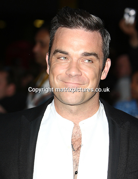 NON EXCLUSIVE PICTURE: MATRIXPICTURES.CO.UK.PLEASE CREDIT ALL USES..WORLD RIGHTS..English singer-songwriter Robbie Williams is pictured attending the GQ Men of the Year Awards at London's Royal Opera House...SEPTEMBER 4th 2012..REF: GBH 123640
