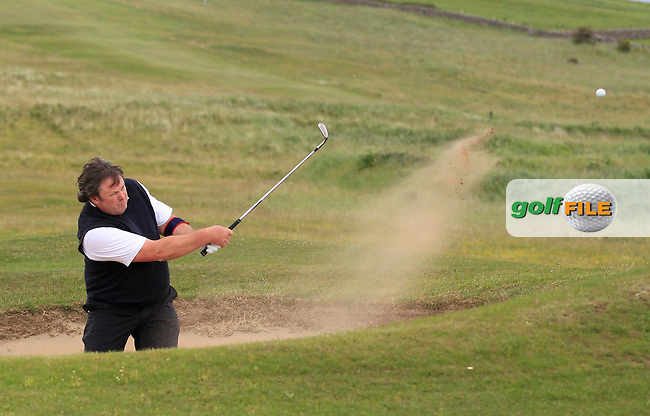 Tommy Grehan (Roscommon) plays out of a bunker on the 3rd during the Athlone V Westport Connacht Senior Cup Final at Co.Sligo Golf Club in Rosses Point on Sunday 28th June 2015.<br /> Picture:  Golffile | Thos Caffrey