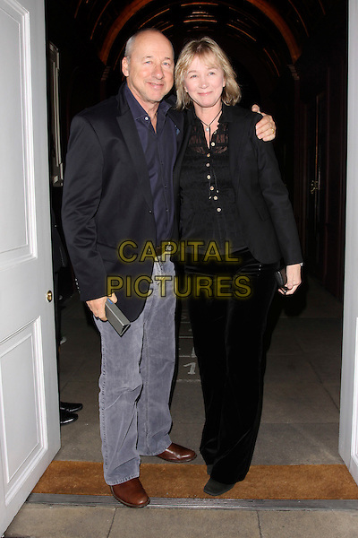MARK KNOPFLER & GUEST .At the Salman Rushdie Book Launch event, Sketch, London, England, UK, October 11th 2010..full length black jacket jeans navy blue shirt arm around couple .CAP/AH.©Adam Houghton/Capital Pictures.