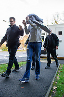"Pictured: Mark Hayter (C) arrives at Merthyr Tydfil Crown Court, Wales, UK. Tuesday 05 November 2019<br /> Re: Blundering ram raiders who escaped with an ATM machine containing £80,000 unaware it was fitted with a secret tracking device, have been jailed for a total of twenty years by Merthyr Tydfil Crown Court.<br /> The masked gang took the cash machine to a deserted farmhouse where a security monitoring company picked up its GPS signals.<br /> The money was being ""divvied up"" when police swooped to arrest the five gang members and seize a bin bag packed with £20 and £10 notes<br /> A jury was shown dramatic video of the gang reversing a 4X4 vehicle into a Valleys Co-op store in the early hours.<br /> Prosecutor Alex Greenwood said: ""The peace of Treharris village was interrupted by an audacious criminal enterprise.<br /> ""It was a highly-organised burglary to remove the ATM from the Co-op store.<br /> ""A masked criminal gang reversed a Mitsubishi pick-up into the front of the shop. <br /> ""Straps were attached to the machine and the pick-up drove off dragging it down the street with sparks flying off it."