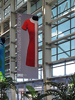 "Banner announcing the ""Fashion in Flight: Airline Uniform Design"" exhibition of SFO Museums at the San Francisco Airport Commission Aviation Library and Louis A. Turpin Aviation Museum in the international terminal of San Francisco International airport (SFO), San Francisco, California"