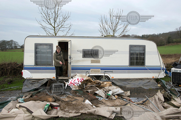 Julie Hoggarth throws out an artificial Christmas tree as she salvages belongings from her home. A community of between 20 and 30 people lost their homes as static caravans and mobile homes were swept from their pitches in the grounds of the Esholt Sports and Leisure Club by floodwaters from the River Aire, and deposited further downstream.