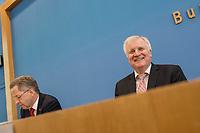 """Bundesinnenminister Horst Seehofer (CSU) und  der Praesident des Bundesamt fuer Verfassungsschutz (BfV), Hans-Georg Maassen stellten am Dienstag den 24. Juli 2018 in Berlin den """"Verfassungsschutzbericht 2017"""" vor.<br /> In dem Bericht werden die Erkenntnisse des BfV zu """"verfassungsfeindlichen Bestrebungen"""" zusammenfasst. Dazu gehoeren Zahlen zur """"Politisch Motivierten Kriminalitaet"""", wie zum Beispiel rechtsextremistische Straftaten. Enthalten sind auch Statistiken und Analysen zu Gruppen, die als militant islamistisch eingestuft werden. Der Termin wurde mehrfach verschoben.<br /> Im Bild vlnr.: Hans-Georg Maassen und Horst Seehofer.<br /> 24.7.2018, Berlin<br /> Copyright: Christian-Ditsch.de<br /> [Inhaltsveraendernde Manipulation des Fotos nur nach ausdruecklicher Genehmigung des Fotografen. Vereinbarungen ueber Abtretung von Persoenlichkeitsrechten/Model Release der abgebildeten Person/Personen liegen nicht vor. NO MODEL RELEASE! Nur fuer Redaktionelle Zwecke. Don't publish without copyright Christian-Ditsch.de, Veroeffentlichung nur mit Fotografennennung, sowie gegen Honorar, MwSt. und Beleg. Konto: I N G - D i B a, IBAN DE58500105175400192269, BIC INGDDEFFXXX, Kontakt: post@christian-ditsch.de<br /> Bei der Bearbeitung der Dateiinformationen darf die Urheberkennzeichnung in den EXIF- und  IPTC-Daten nicht entfernt werden, diese sind in digitalen Medien nach §95c UrhG rechtlich geschuetzt. Der Urhebervermerk wird gemaess §13 UrhG verlangt.]"""